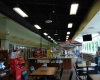 The store design includes space for The Station's dine-in or carryout pizza and a large drink station