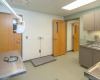 The exam room offers a flexible space for intake and other procedures.