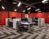 Office area shows how WSKF integrated Kalmar's brand red and shipping containers for work spaces/functions throughout the office