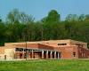 The Riverside Community Center combines indoor amenities with an outdoor pool.
