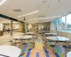 Cafeteria seating gives a sense of the color scheme and use of natural light