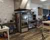 The layout provides customers a view of the kitchen and the bakers at work