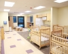 The infant's room is one of several age-specific child care areas within the center