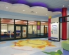 The main lobby blends terrazzo flooring, custom fabricated elements and colorful three-dimensional graphics.