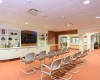 A large TV/Multipurpose Room is inviting and encourages communal activities