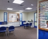 View of the optical shop where families can select frames and children are fitted for their glasses