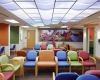 Large collages in upper-floor waiting rooms are part of the child-focused design