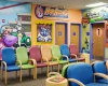 """The waiting area blends WSKF Architects' design and the art of Don """"Scribe"""" Ross, an in-house artist at Children's Mercy."""