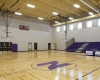 The expansion included a new gymnasium for practices and events with adjacent accessory locker rooms and gymnasium equipment storage