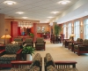 The lobby creates a warm and welcoming aesthetic for visitors