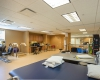 The existing exercise room was repurposed for a mix of exercise and large physical therapy space.
