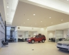 The showroom provides ample space for vehicles and nearby sales offices