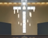 Cross-shaped windows bring in natural light behind the pulpit