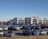 The project features a 27,500-sq-ft dealership sales and service facility on a four-acre site