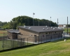 The new 3,300-sq-ft home locker room building includes offices and easy dugout access