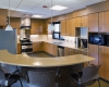 The kitchen design incorporates a range of recycled and other sustainable materials.