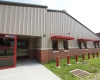 Entrance and adjacent metal window canopies add visual appeal and color